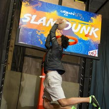 Boy throws down a jam in our trampoline slam dunk zone