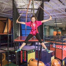Girl riding the indoor sky coaster