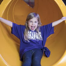 Girl enjoys a Tube slide at Urban Air Tubes