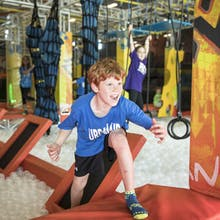 Boy on warrior obstacle course