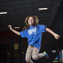 Girl flies high on the Apex Trampolines at Urban Air